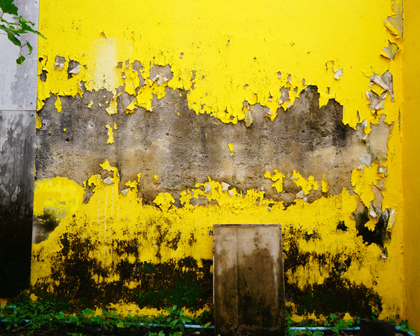Yellow wall with rust stains