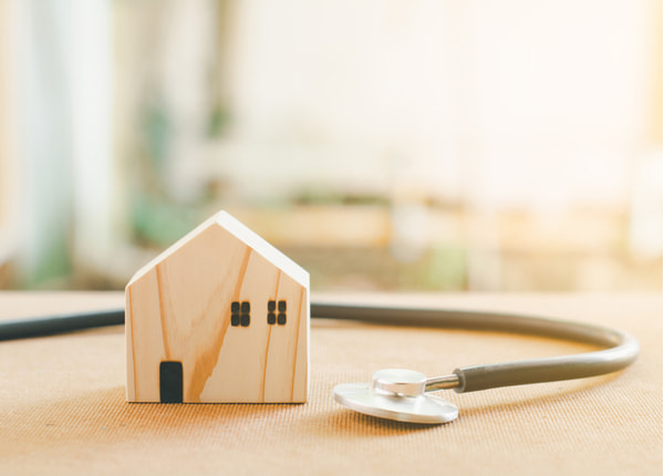 Stethoscope and wooden home