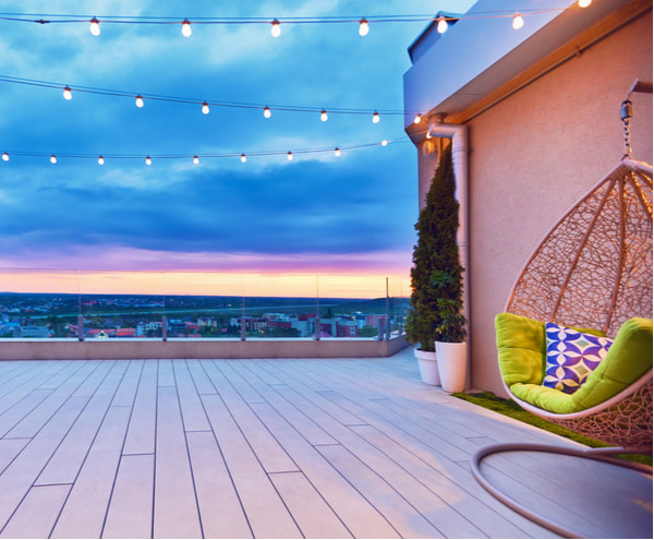 Rooftop deck patio area with hanging chair