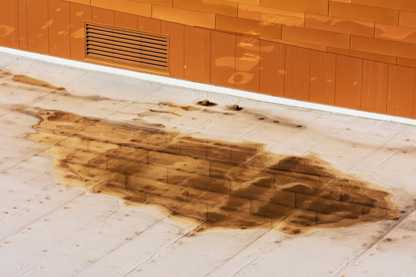 Ponding dirty water on settled flat roof