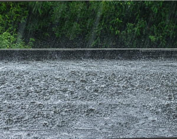 Heavy rain on a black flat roof