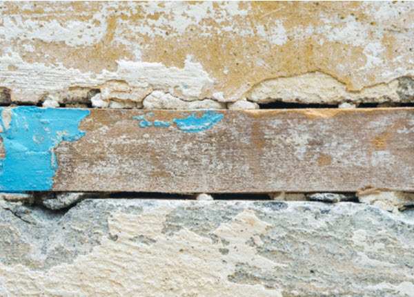 Wood placed between concrete blocks on the wall