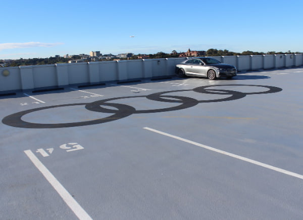 Parking lot with Audi logo