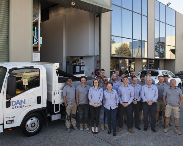 Company team having a group picture outside the building