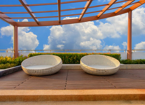 Relax corner on condominium rooftop garden with chairs