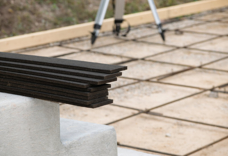 Pile of Expansion Joint and Rebar Grid on a Concrete floor