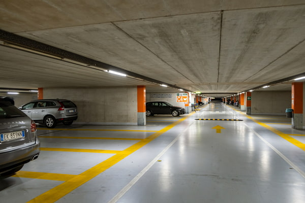 Modern cars parked inside closed underground parking lot