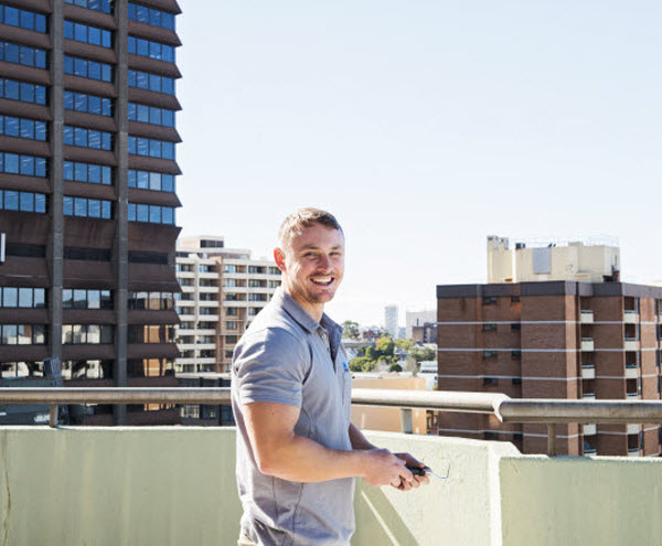 Man on the rooftop smiling at the camera