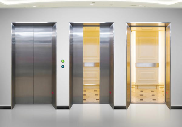 Open and closed chrome metal office building elevator doors